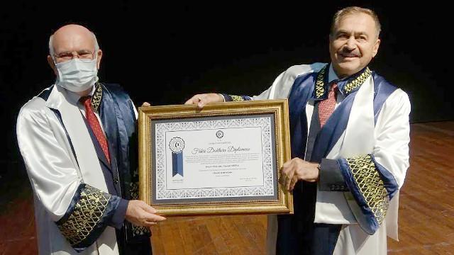 Eroğlu, hocasına vekaleten fahri doktora diploması aldı